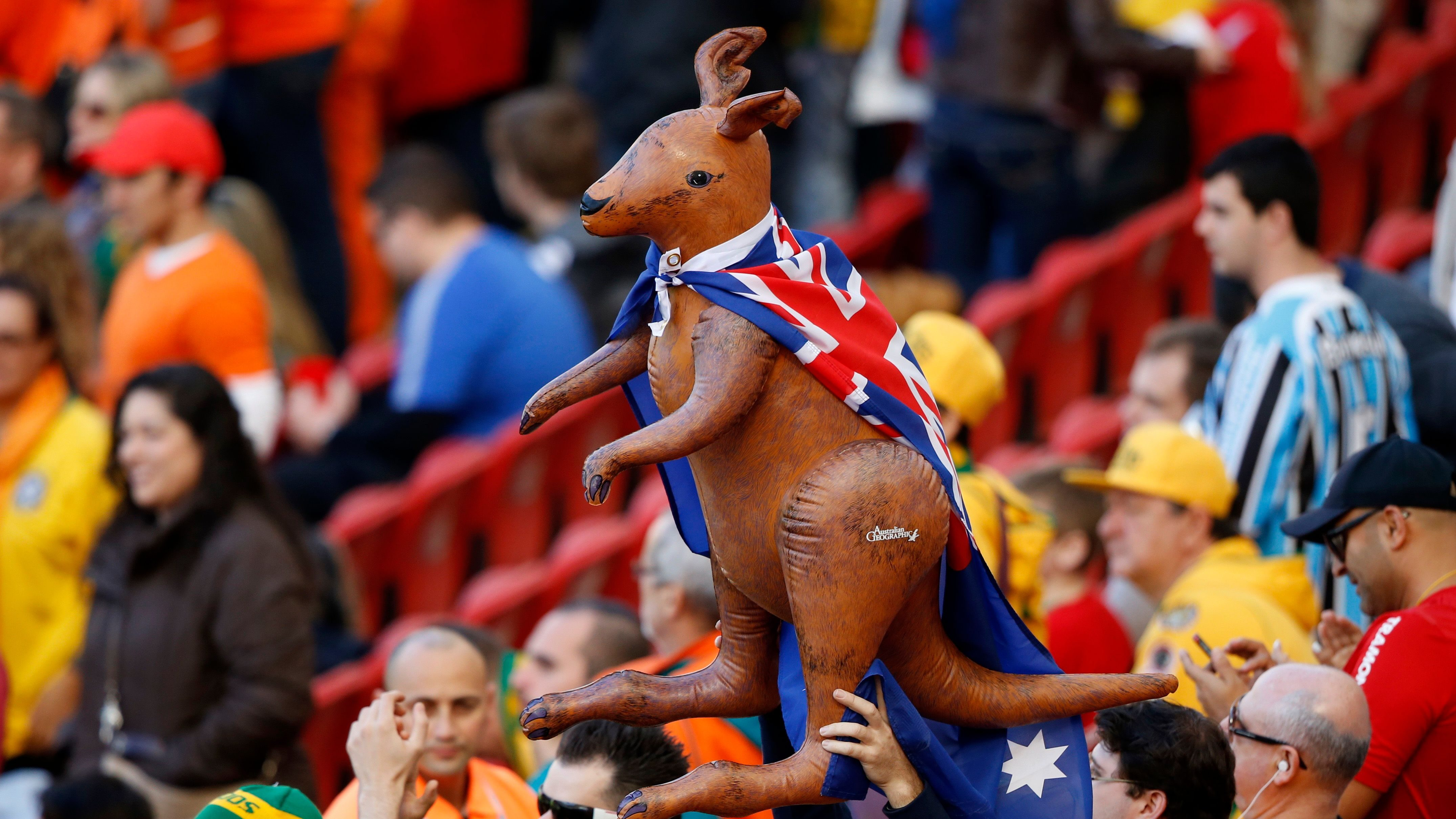 Australia fans hold an inflatable kangaroo wearing an Australia flag before the team's 2014 World Cup Group B soccer match against Netherlands at the Beira Rio stadium in Porto Alegre June 18, 2014. REUTERS/Marko Djurica (BRAZIL - Tags: SOCCER SPORT WORLD CUP) - TB3EA6I1AUN3B