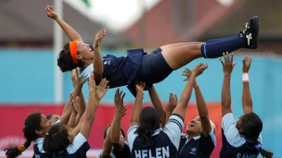 The Indian ladies hockey team toss their captain Surja Waikhom into the air