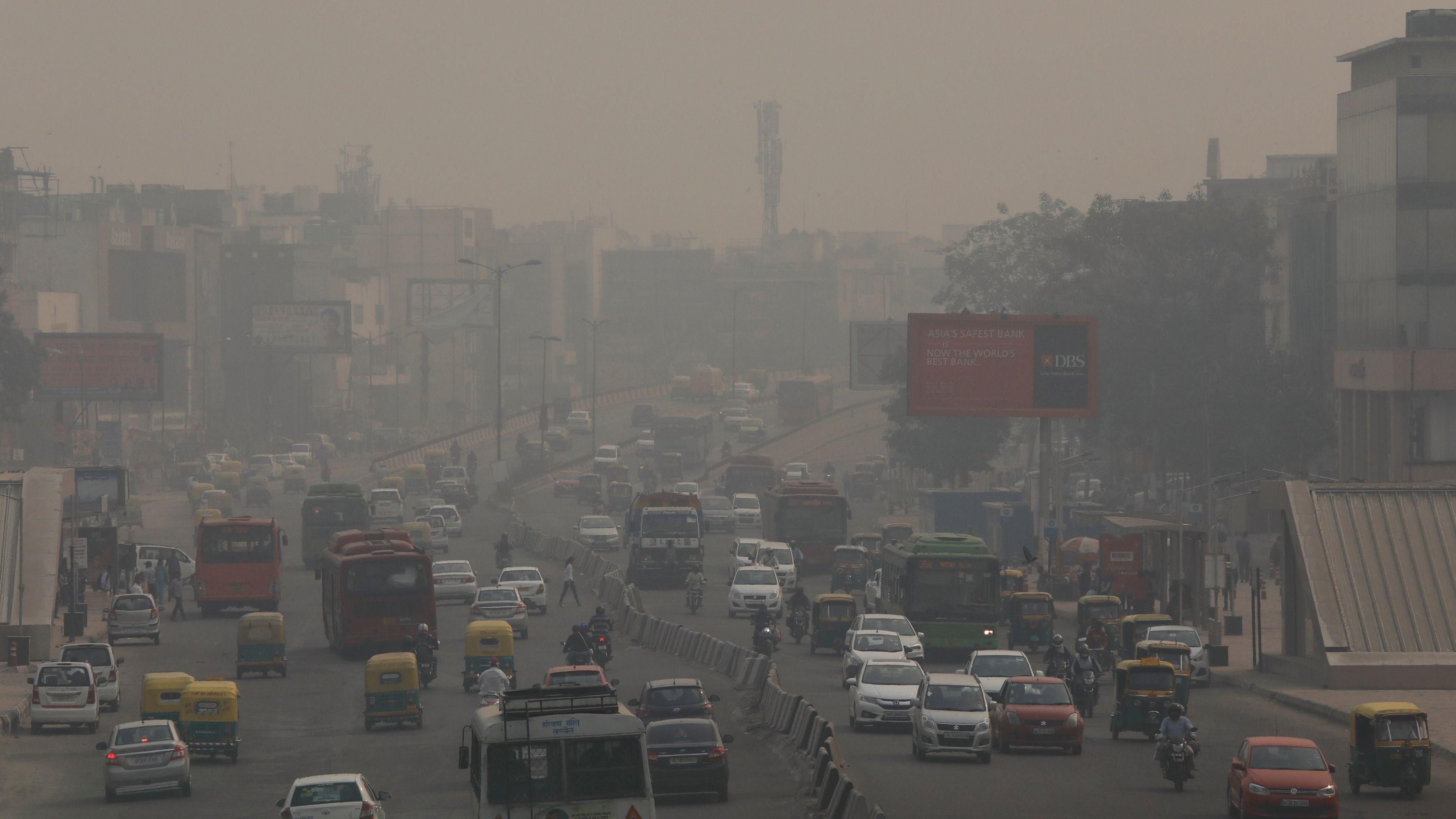 Vehicles drive through smog in New Delhi, India, November 8, 2018.