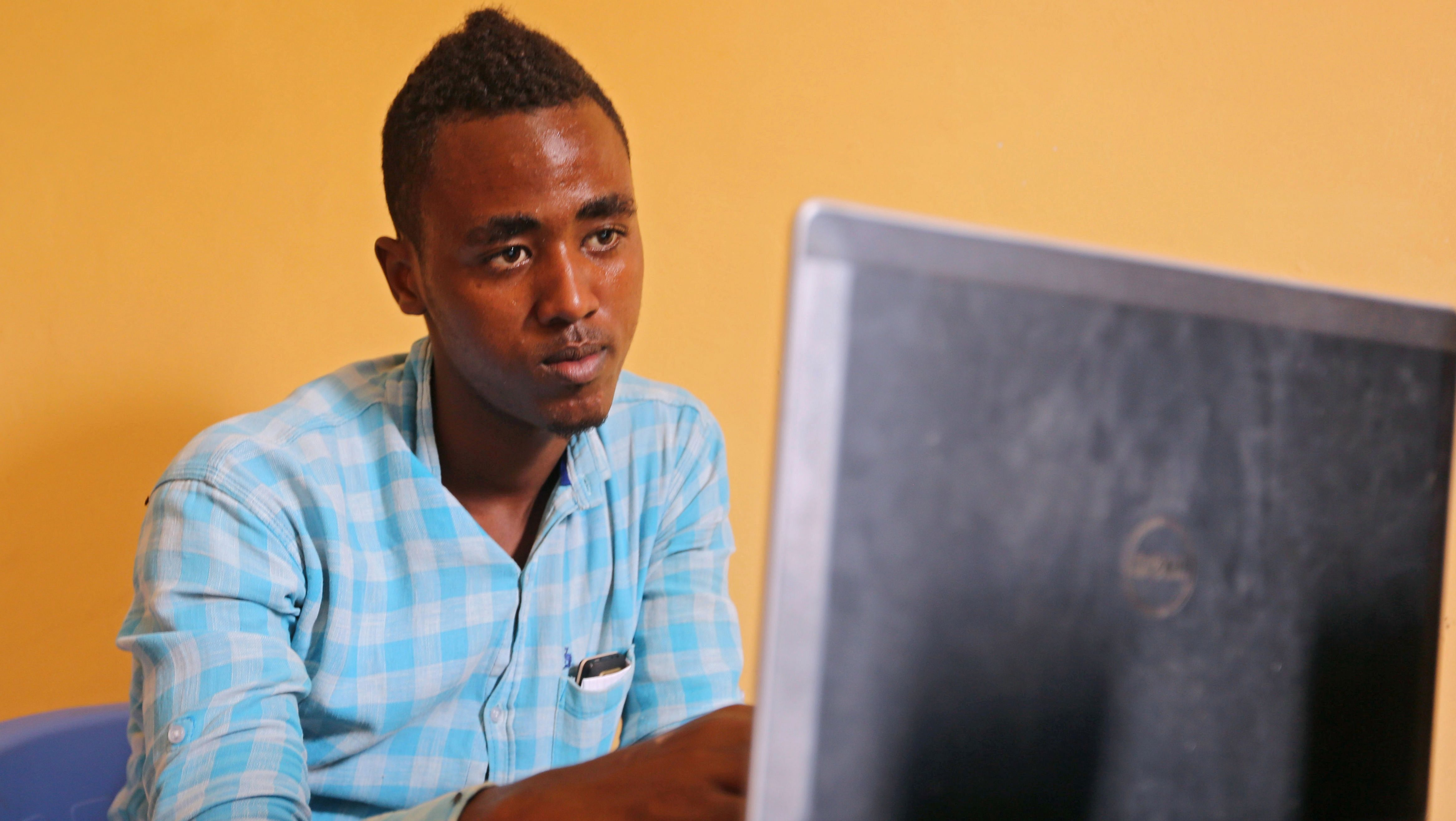 A client browses the internet at a cyber cafe in Mogadishu, Somalia July 18, 2017.