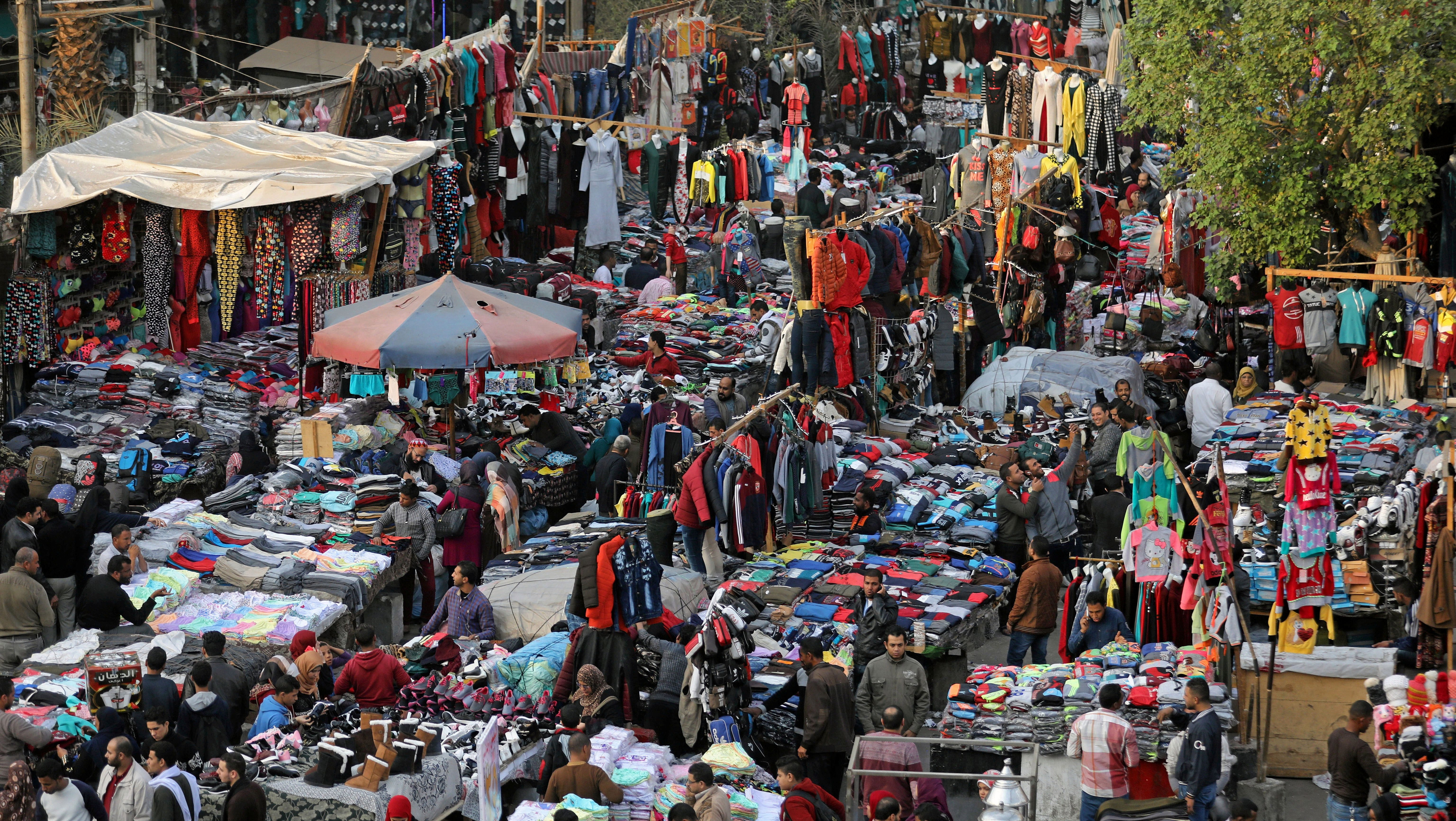 People shop at Al Ataba, a popular market in downtown Cairo, Egypt December 12, 2017.