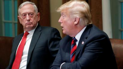 U.S. Defense Secretary James Mattis listens as U.S. President Donald Trump speaks to the news media while gathering for a briefing from his senior military leaders in the Cabinet Room at the White House in Washington, U.S., October 23, 2018. REUTERS/Leah Millis - RC168EE59270