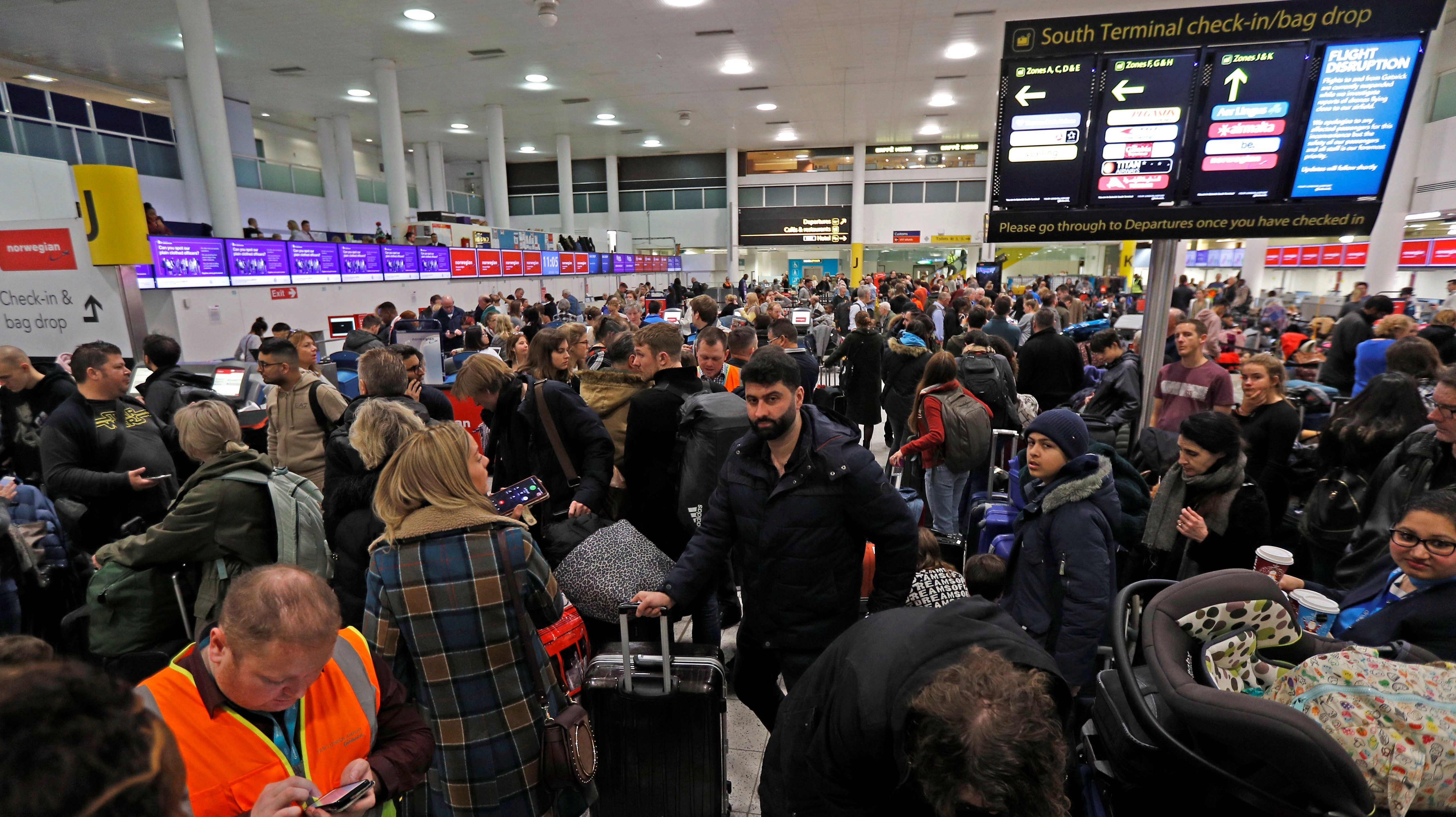 Passengers wait around in the South Terminal building at Gatwick Airport after drones flying illegally over the airfield forced the closure of the airport, in Gatwick, Britain, December 20, 2018.