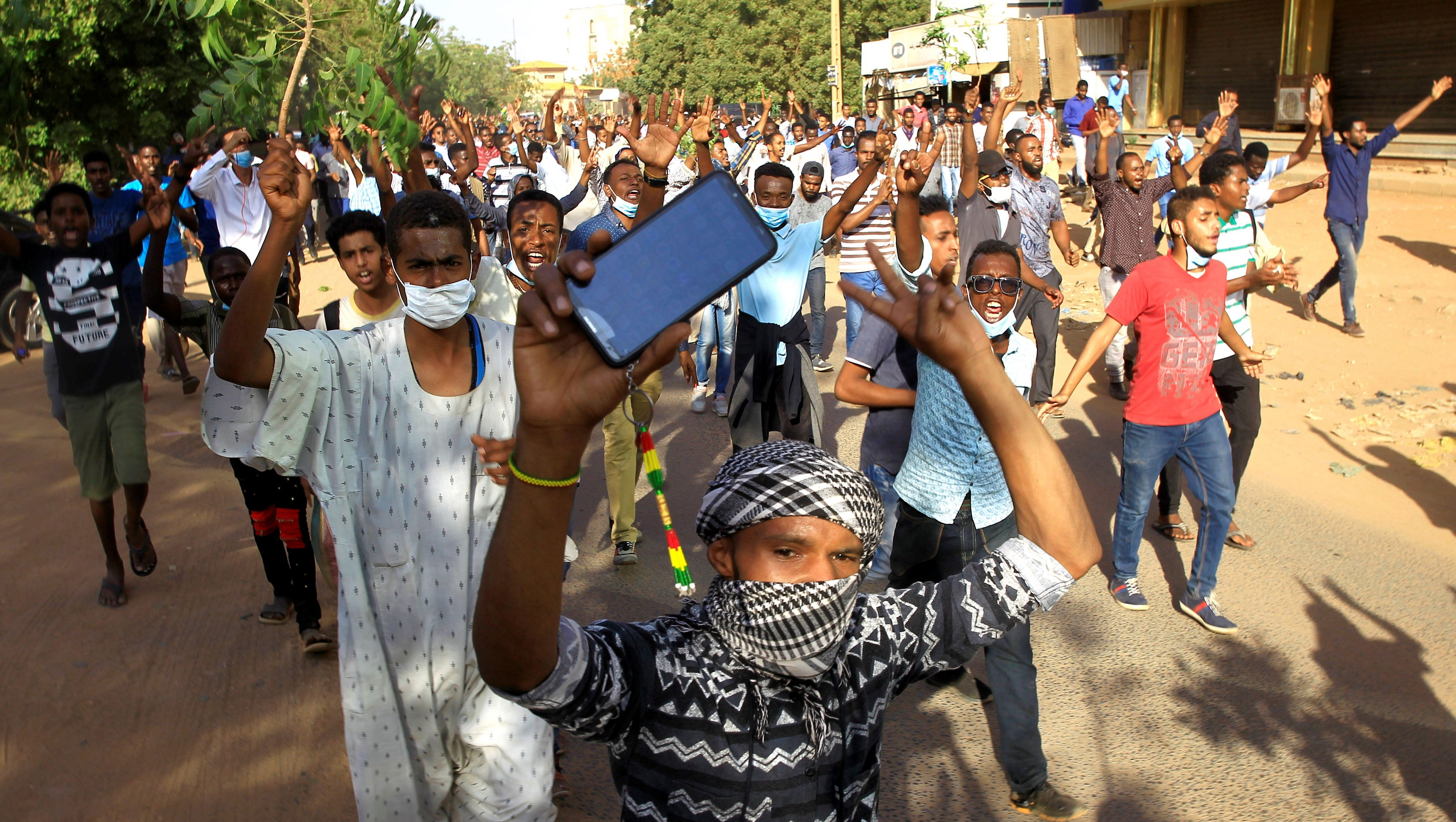 Sudanese demonstrators chant slogans as they march along the street during anti-government protests in Khartoum, Sudan December 25, 2018.
