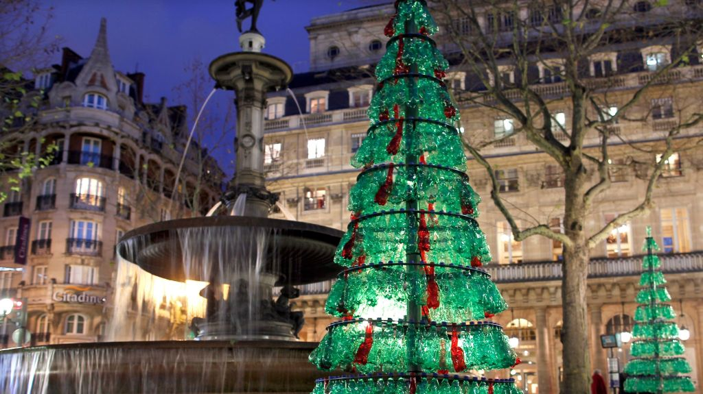A Christmas tree made from used plastic bottles decorates a street in the centre of Paris