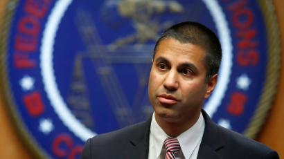 Federal Communications Commission (FCC) Chairman Ajit Pai arrives for an FCC meeting where they will vote on net neutrality, Thursday, Dec. 14, 2017, in Washington.