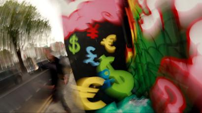 Painted monetary symbols are seen on a wall in Dublin, Ireland, on October 22, 2014.