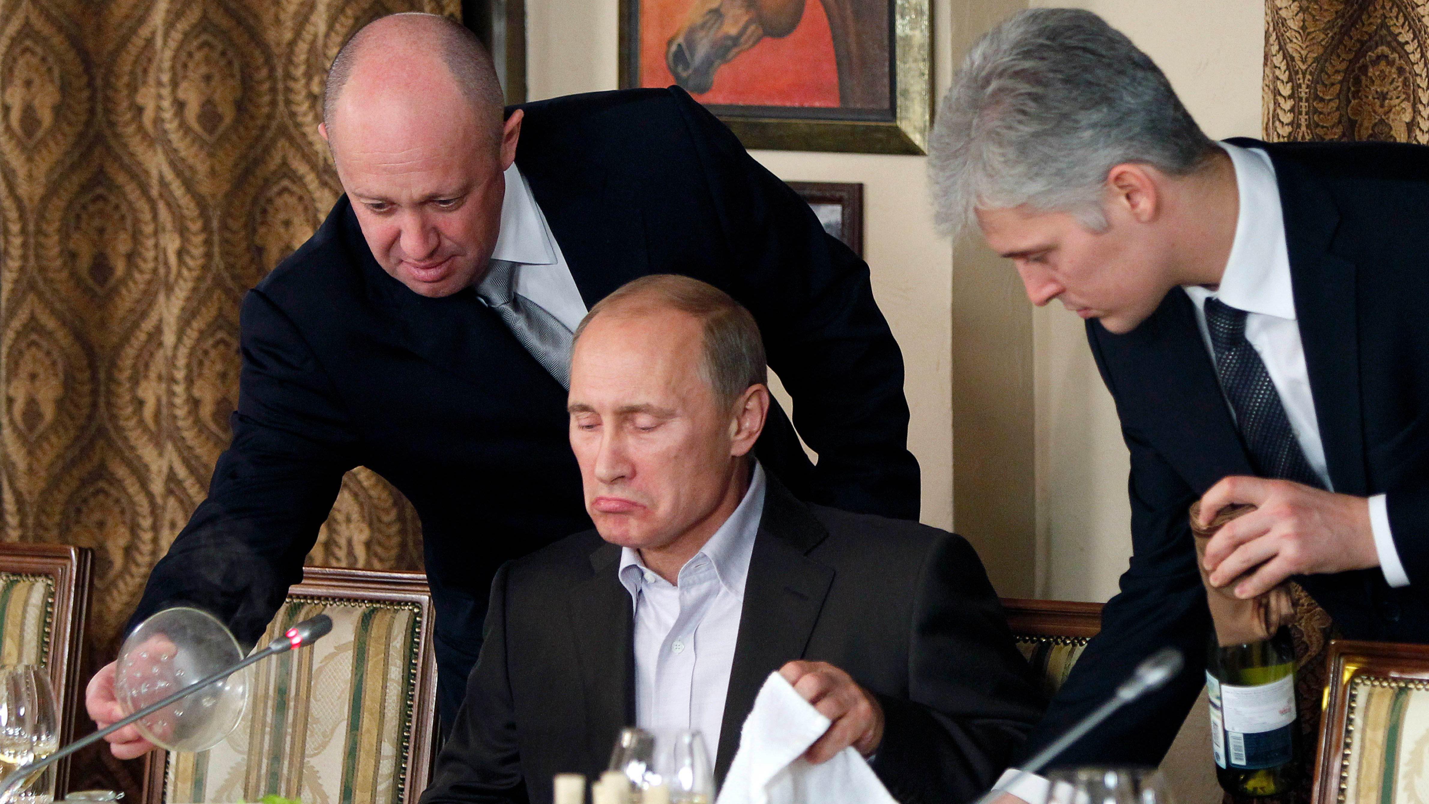 Yevgeny Prigozhin, left, serves Vladimir Putin.