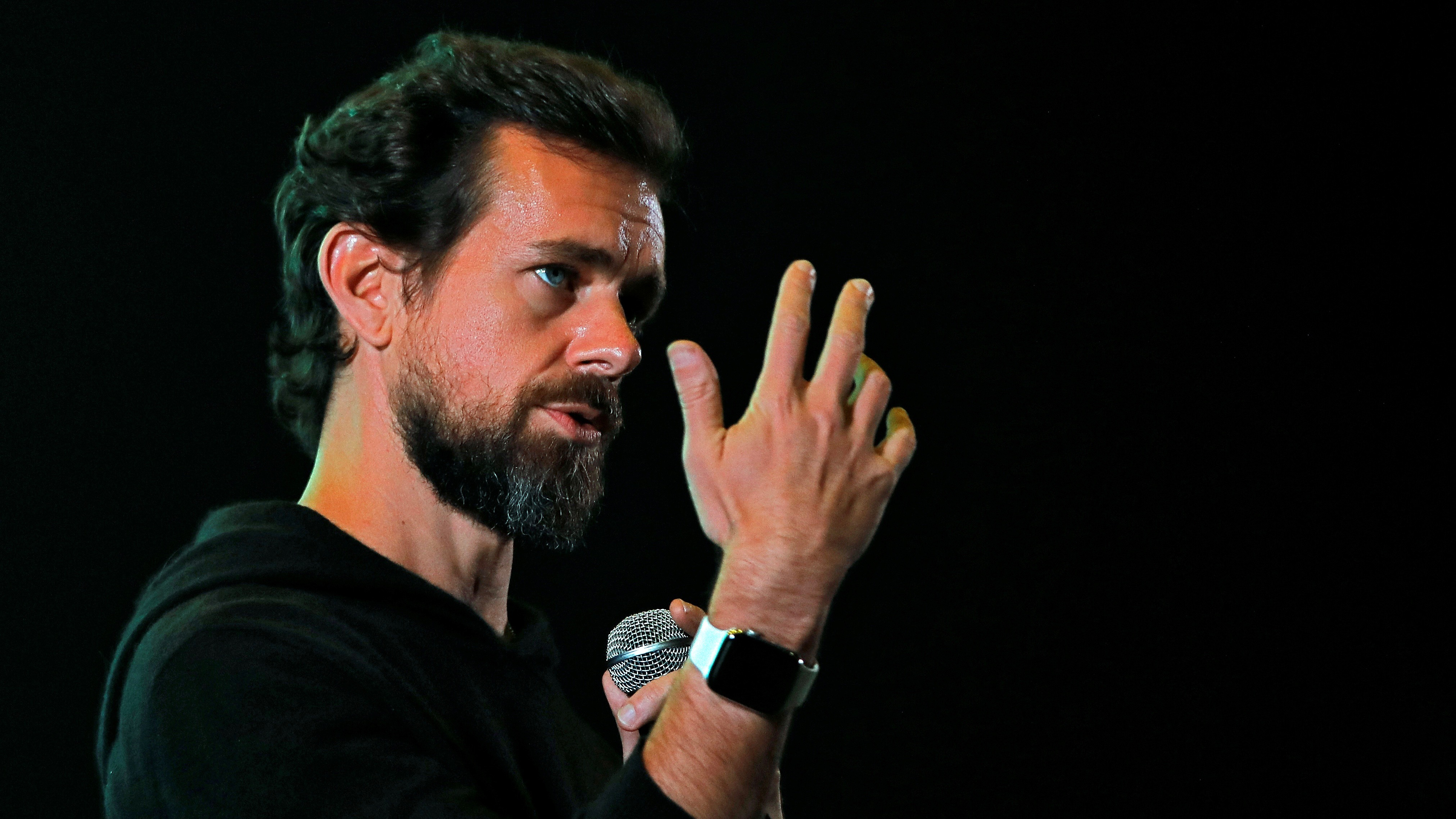 Twitter CEO Jack Dorsey is attached to his Apple watch.