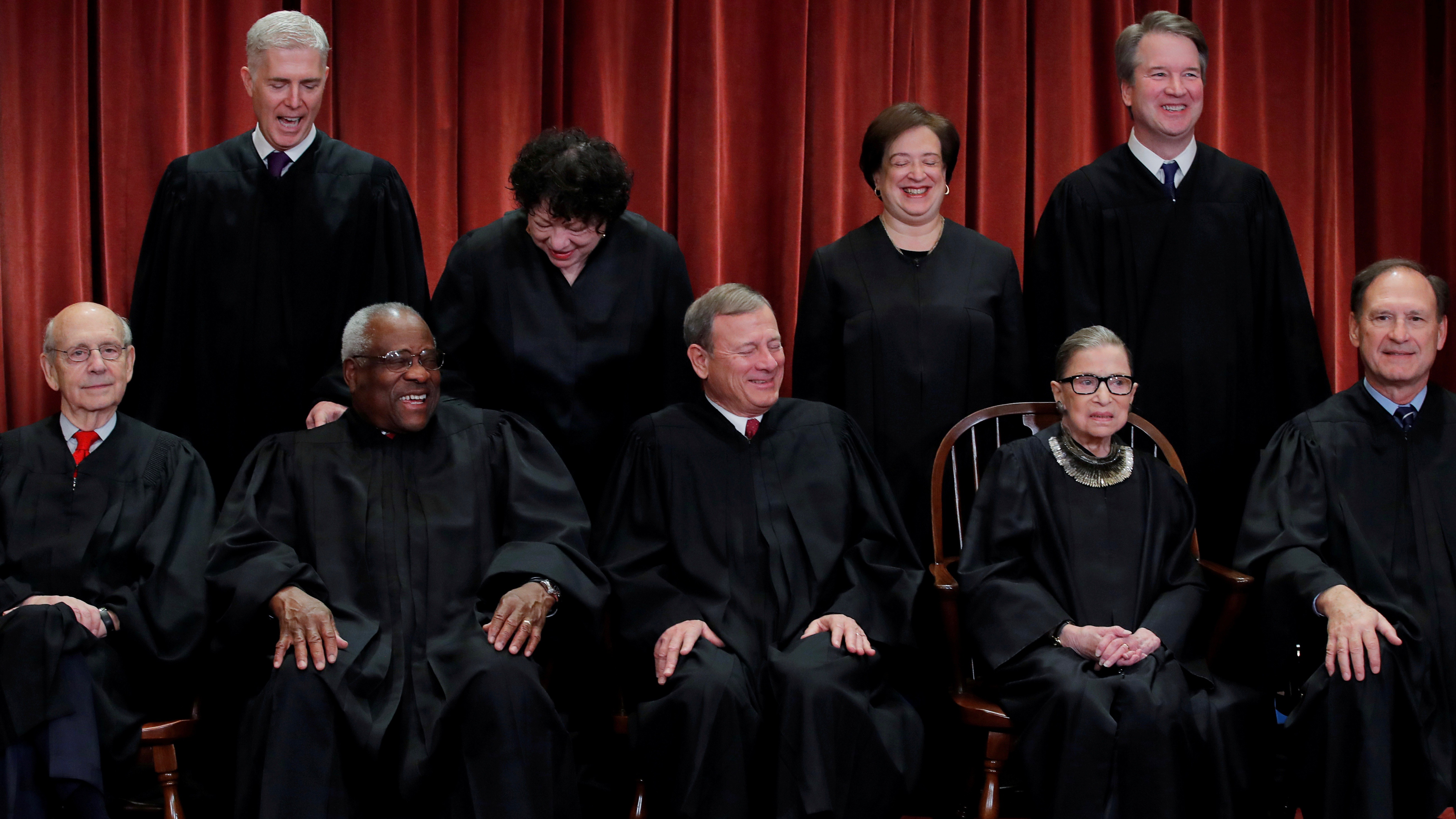 US Supreme Court justices Nov. 30. Seated (L-R): Stephen Breyer, Clarence Thomas, John G. Roberts, Ruth Bader Ginsburg and Samuel Alito, Jr. Standing behind (L-R): Neil Gorsuch, Sonia Sotomayor, Elena Kagan, and Brett Kavanaugh.