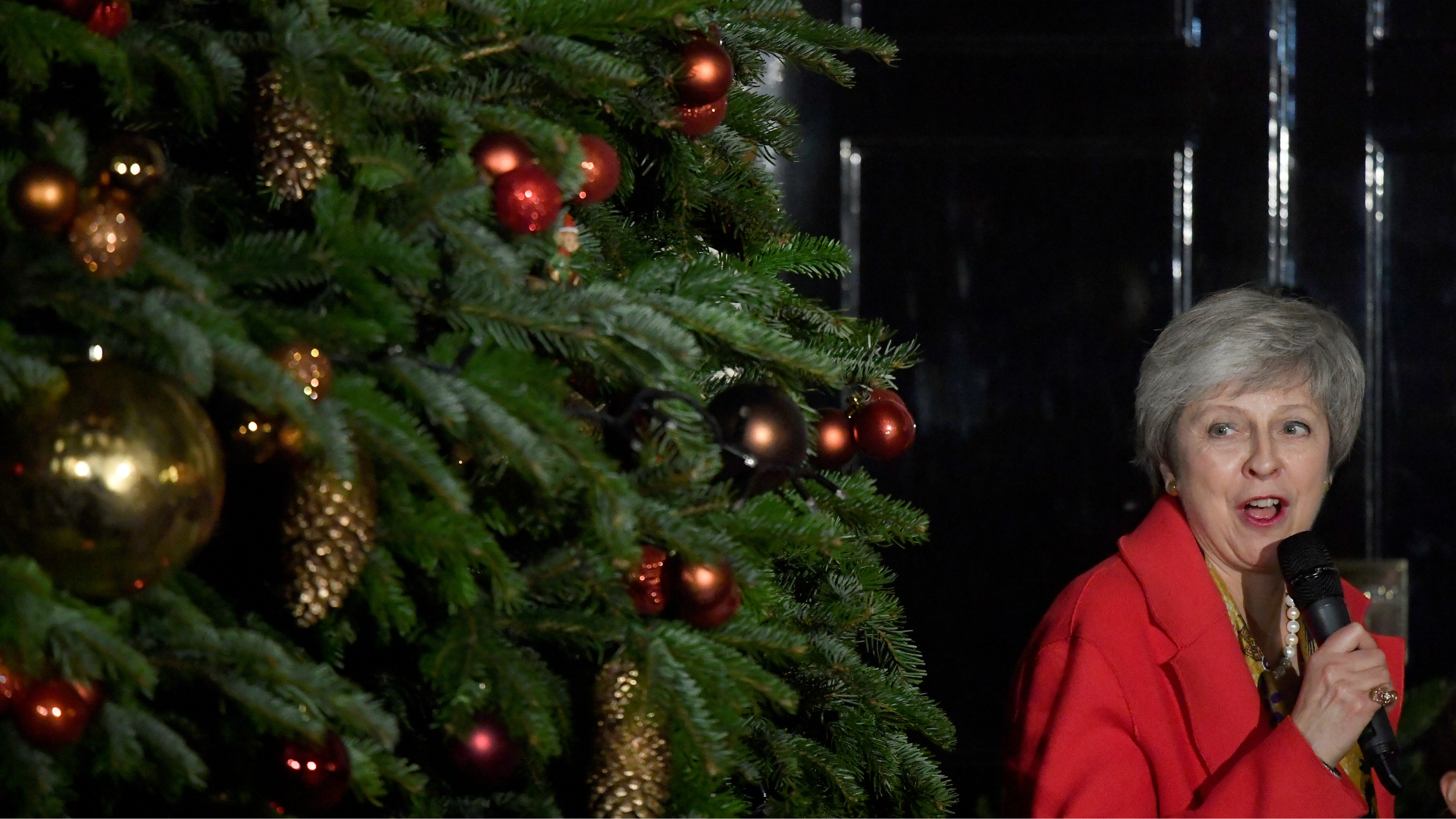 Britain's Prime Minister, Theresa May, uses a microphone during the ceremony of switching on the lights of the Christmas tree in Downing Street,