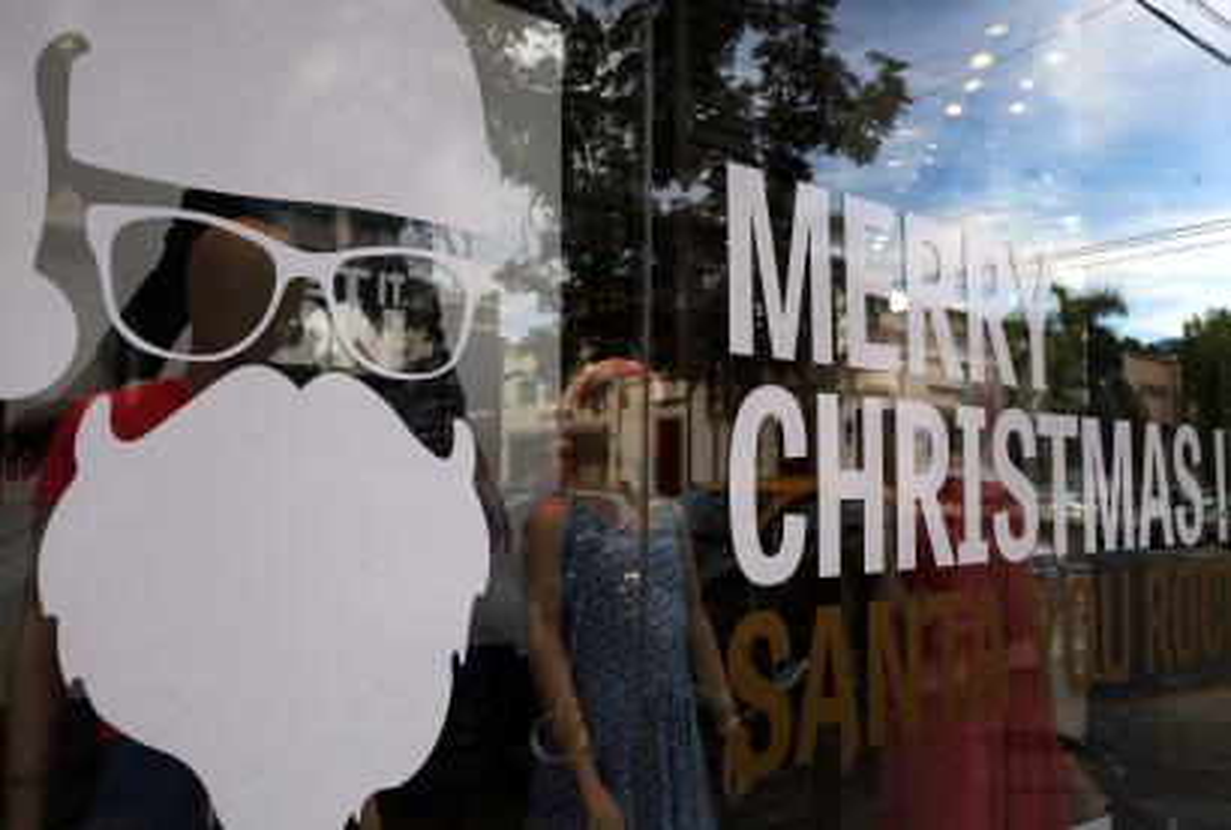 Santa Claus image in store window.