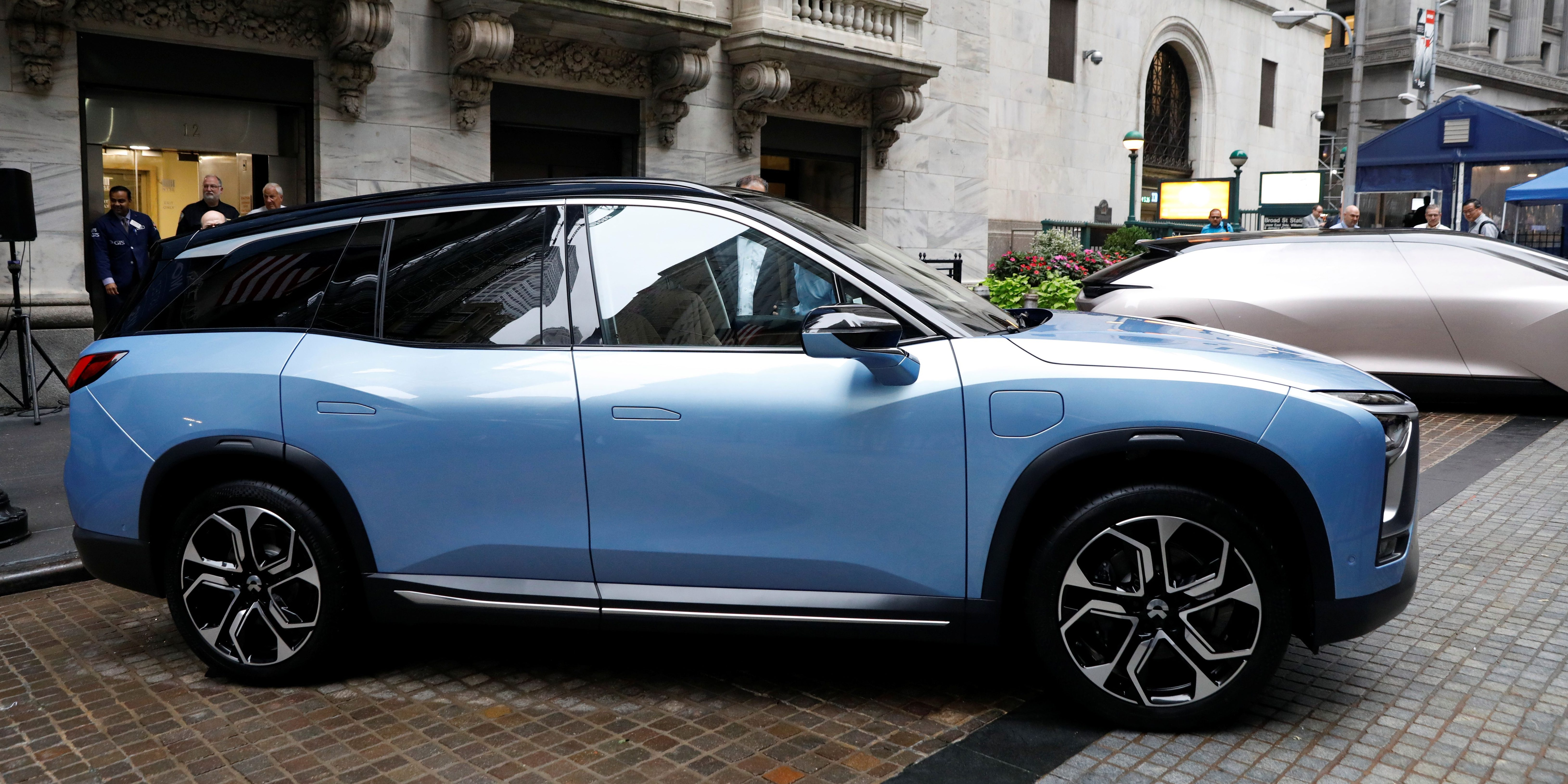 Chinese electric vehicle start-up Nio Inc. vehicles are on display in front of the New York Stock Exchange (NYSE) to celebrate the company's initial public offering (IPO) in New York, U.S., September 12, 2018. REUTERS/Brendan McDermid