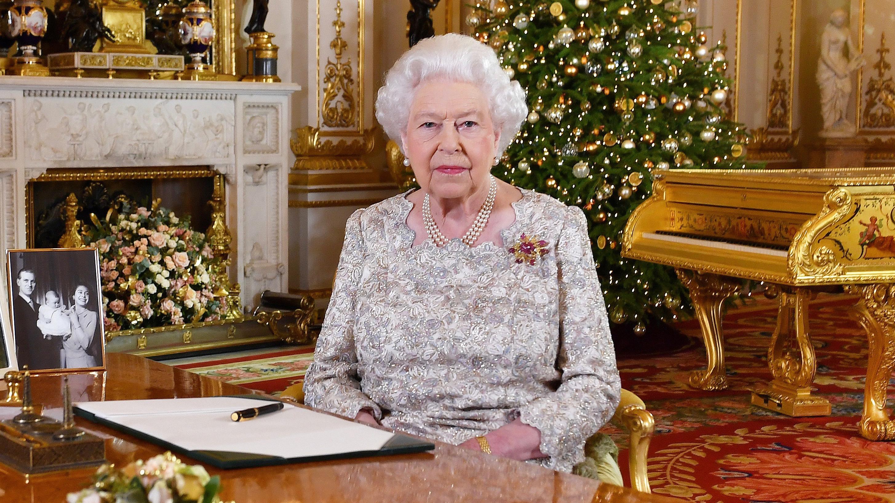 Britain's Queen Elizabeth with gold piano.