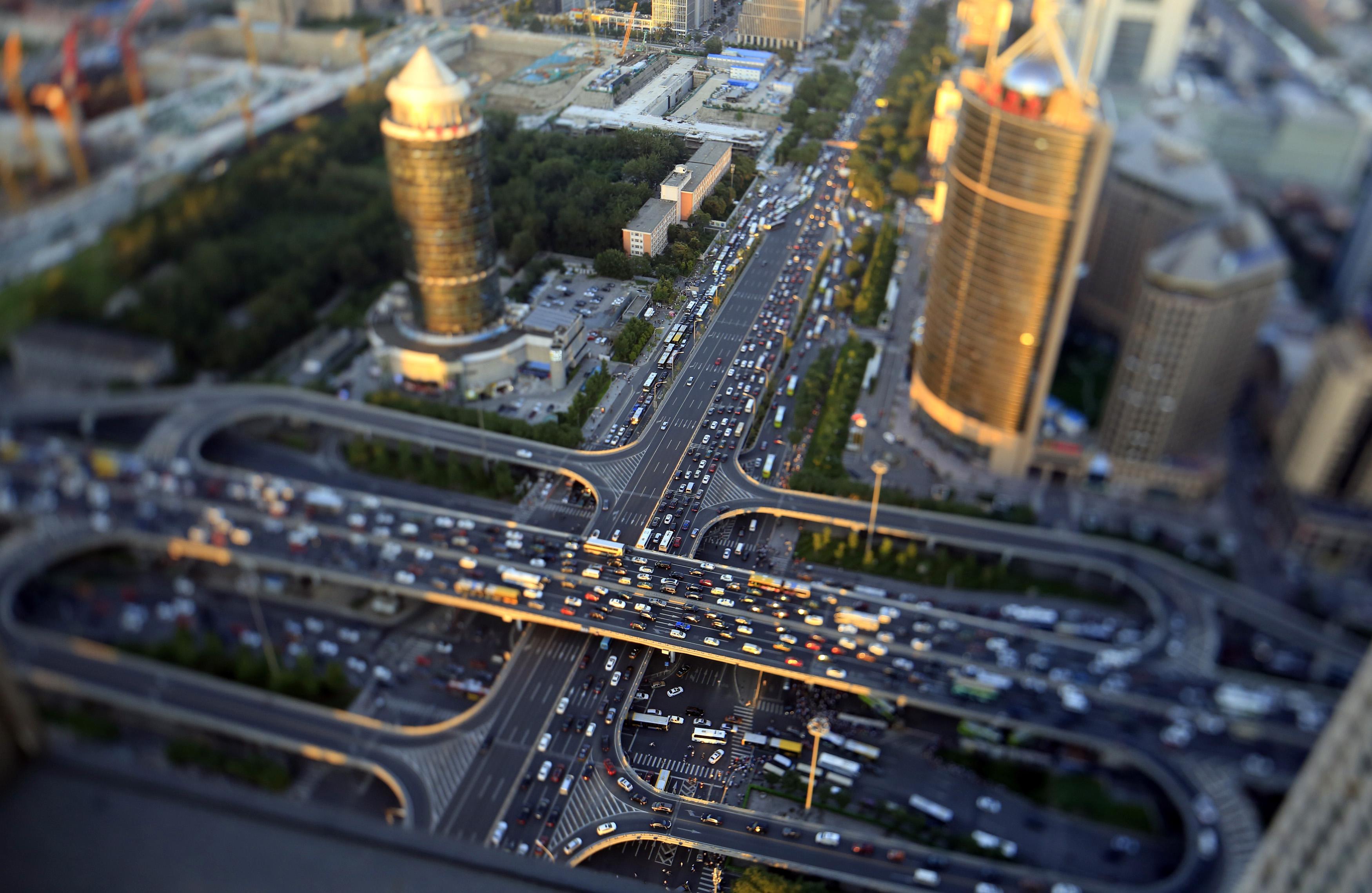 Vehicles drive on the Guomao Bridge during the evening rush hour in Beijing, September 3, 2014. Picture taken using a tilt shift lens.