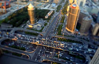 Vehicles drive on the Guomao Bridge during the evening rush hour in Beijing, September 3, 2014. Picture taken using a tilt shift lens.