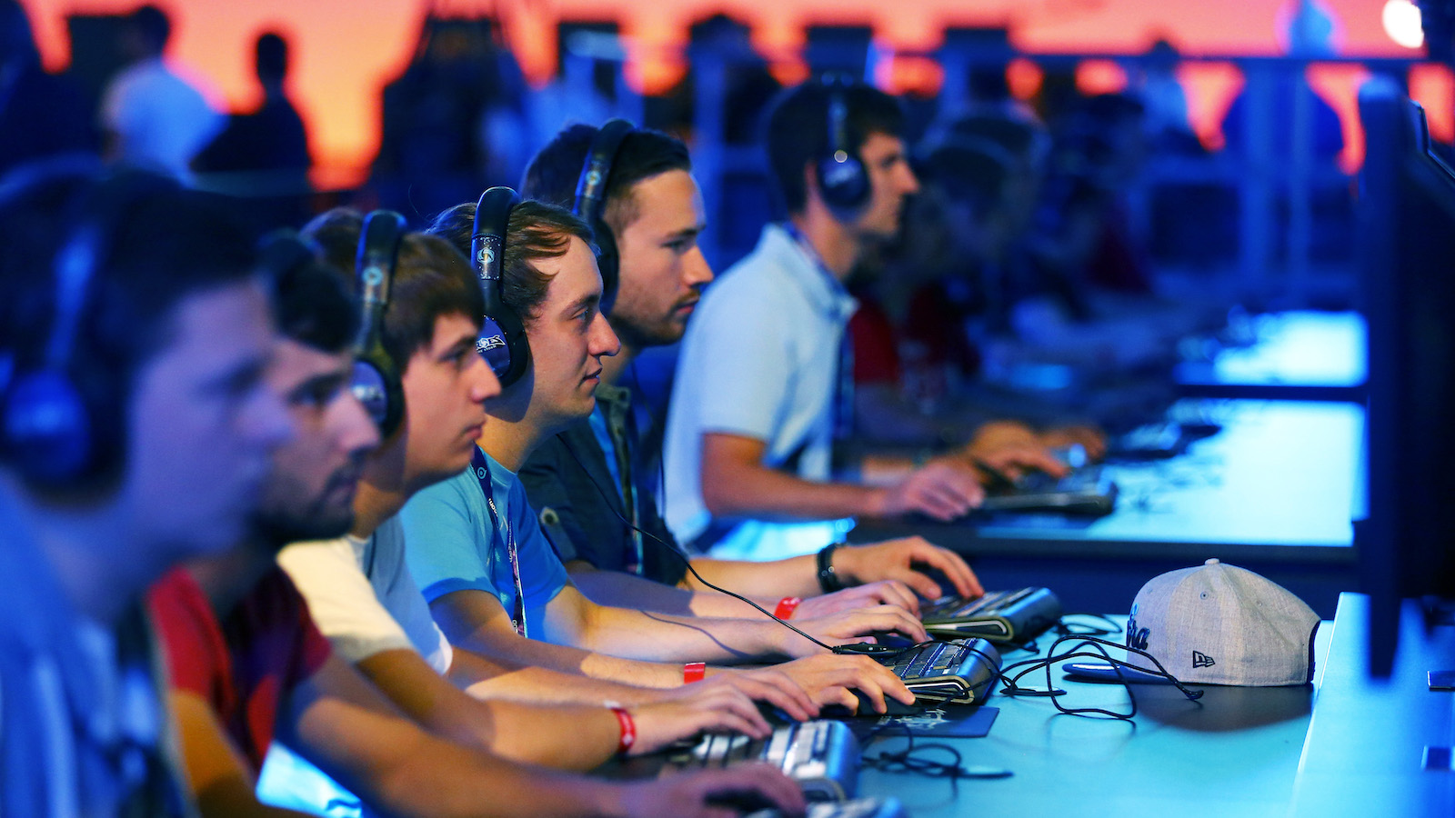 """Visitors play """"Heroes of the Storm"""", developed by video game producer Blizzard Entertainment, using PCs during the Gamescom fair in Cologne"""