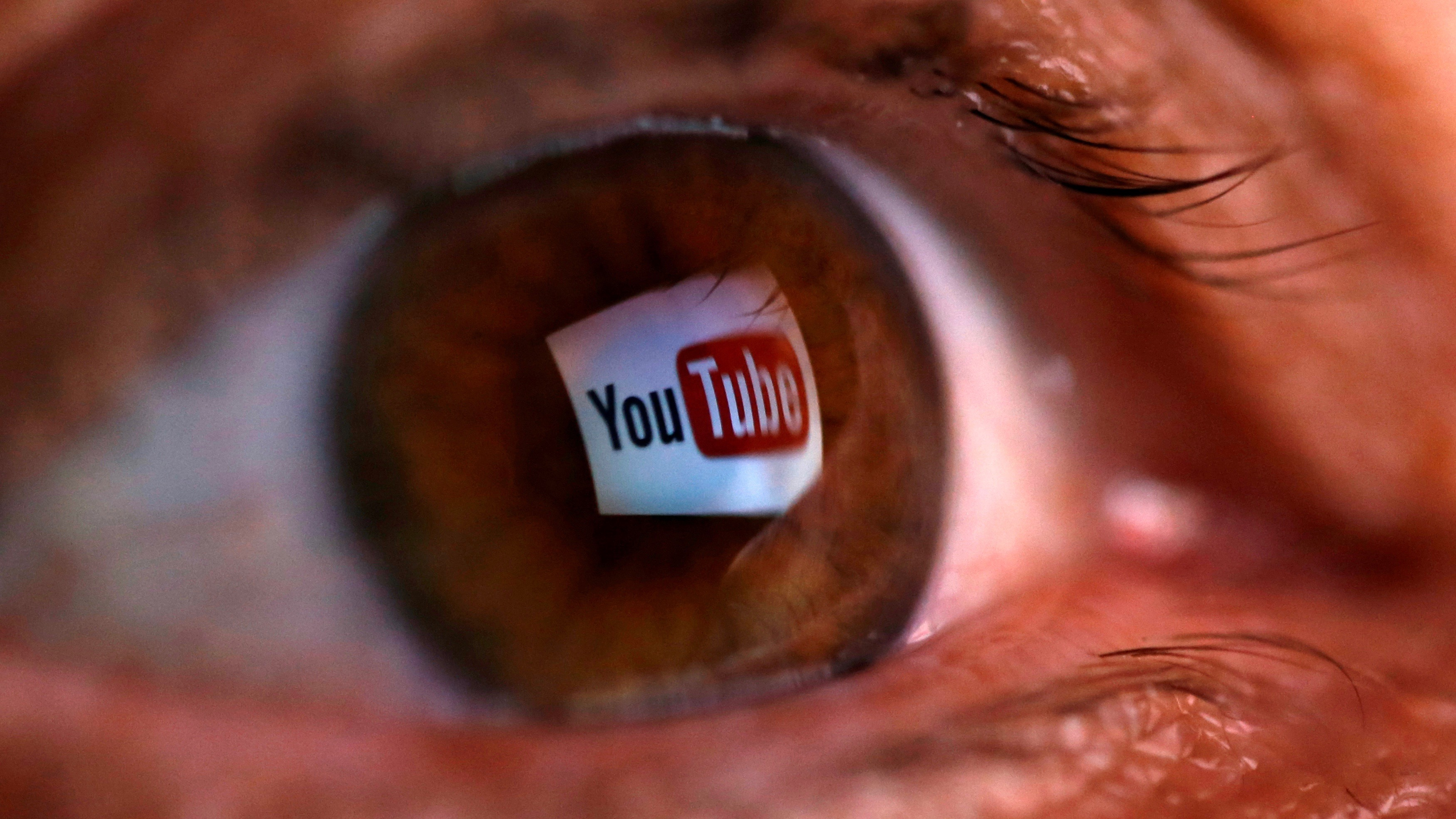 YouTube logo reflected in eye.