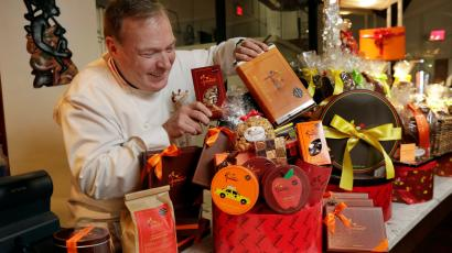 chef-jacques-torres puts the finishing touches on gift baskets.
