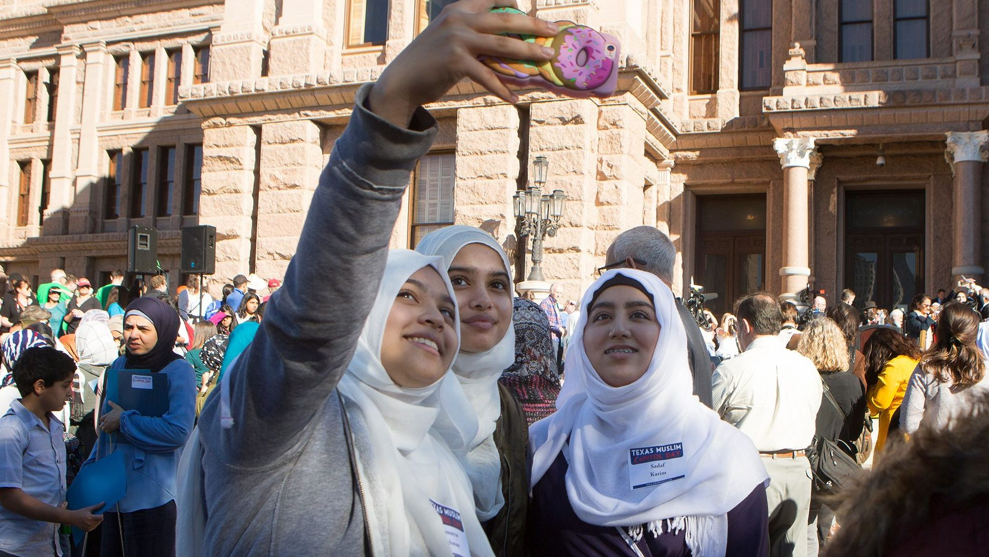 Three muslim women take a selfie during Texas Muslim Capitol Day, Tuesday, Jan. 31, 2017, at the Texas Capitol in Austin, Texas.