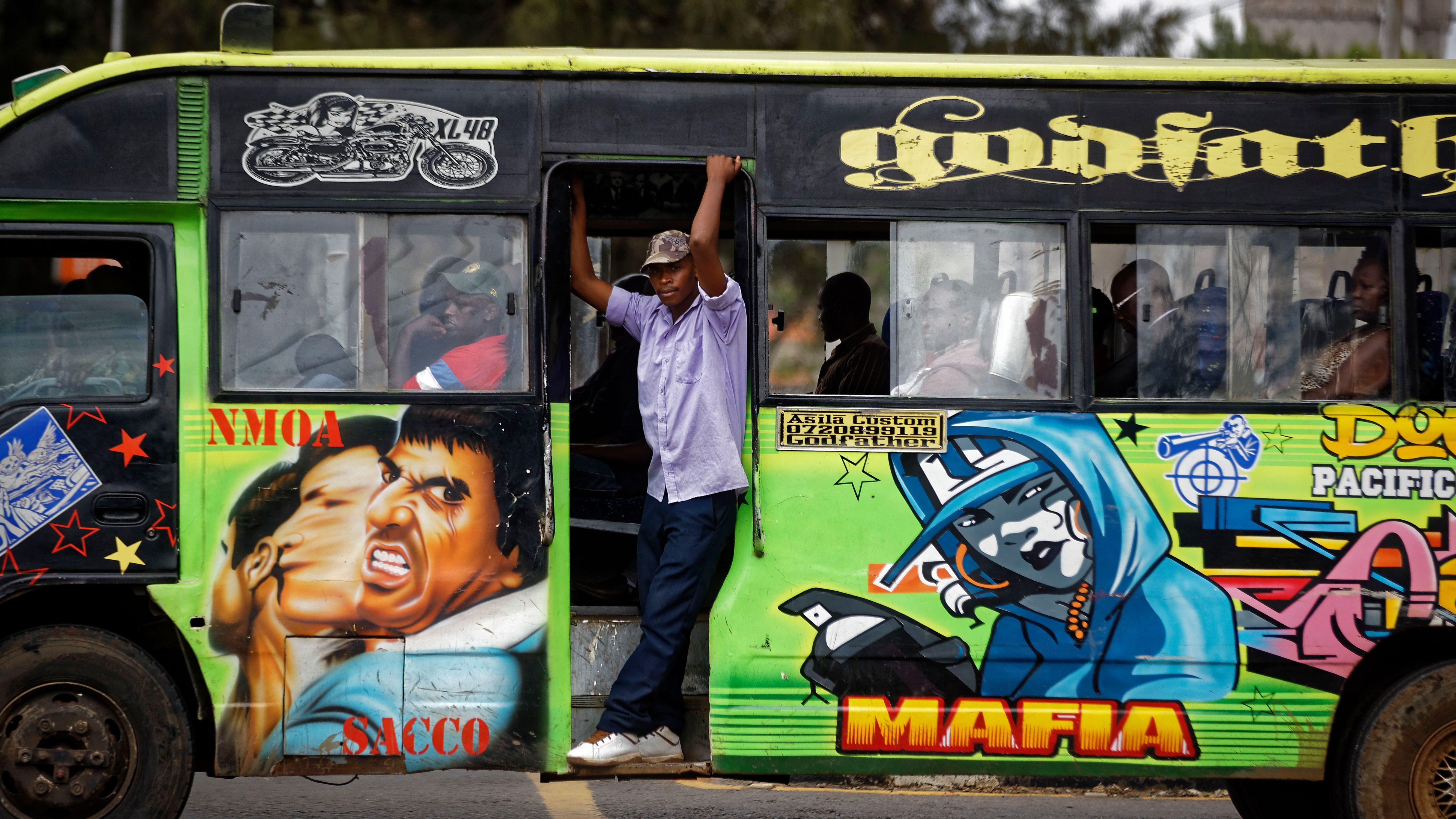 """The conductor of a """"matatu"""" public minibus looks out as supporters of opposition leader Raila Odinga attempt to demonstrate in downtown Nairobi, Kenya Tuesday, Oct. 24, 2017. President Uhuru Kenyatta said on Monday the presidential election must go ahead as planned on Thursday, despite a boycott by Odinga and the chief electoral officer's recent statement that he cannot guarantee that the polls would be credible."""