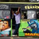 "The conductor of a ""matatu"" public minibus looks out as supporters of opposition leader Raila Odinga attempt to demonstrate in downtown Nairobi, Kenya Tuesday, Oct. 24, 2017. President Uhuru Kenyatta said on Monday the presidential election must go ahead as planned on Thursday, despite a boycott by Odinga and the chief electoral officer's recent statement that he cannot guarantee that the polls would be credible."