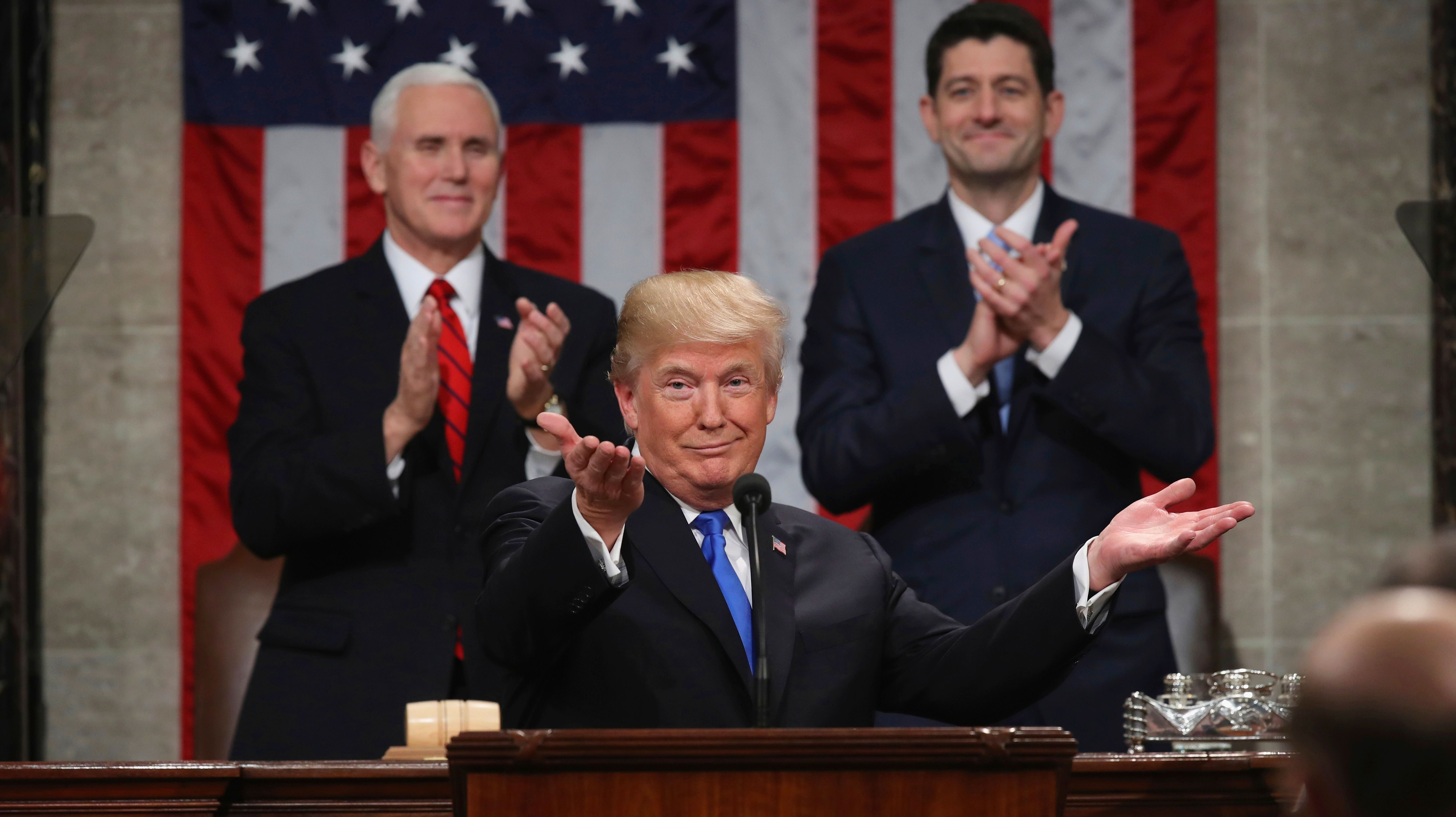 President Donald Trump gestures as delivers his first State of the Union address in the House chamber of the U.S. Capitol to a joint session of Congress Tuesday, Jan. 30, 2018 in Washington, as Vice President Mike Pence and House Speaker Paul Ryan applaud.