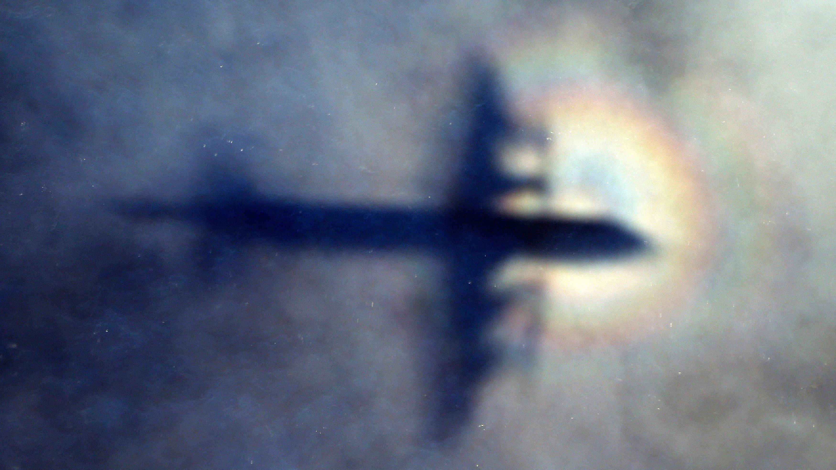 The shadow of a Royal New Zealand Air Force plane is seen as it searches for missing flight MH370 in 2014.