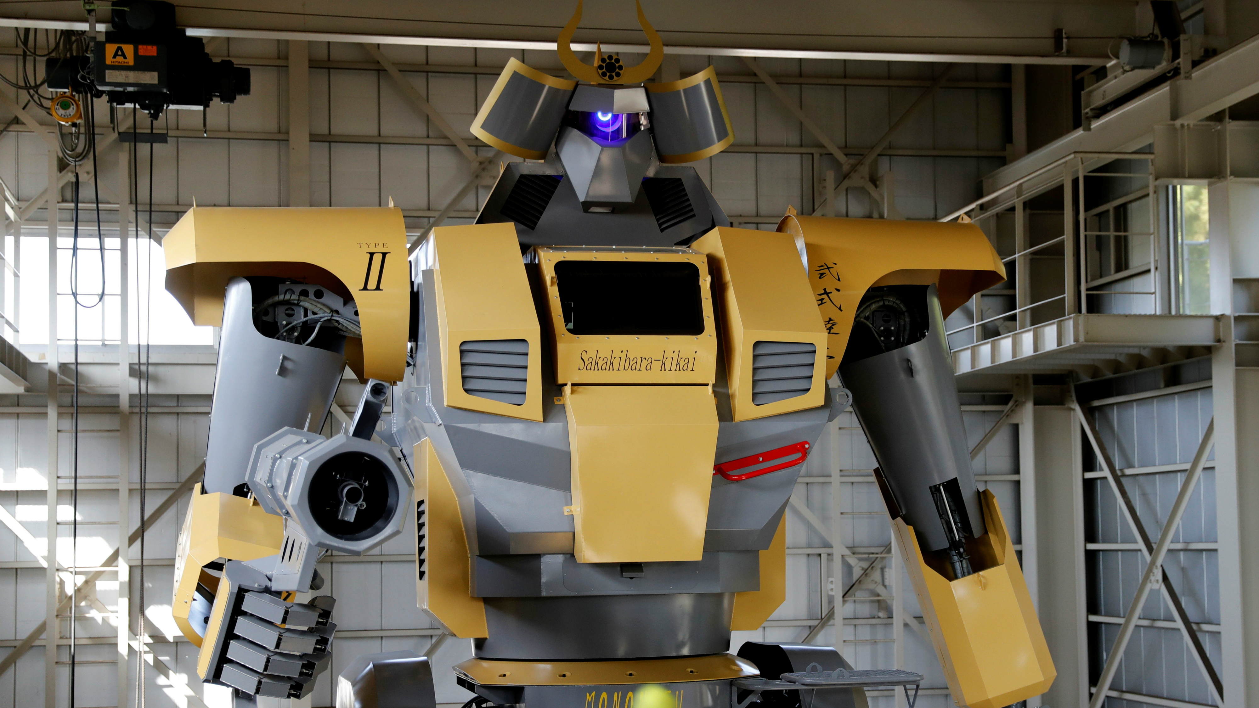 A very large robot in a factory.
