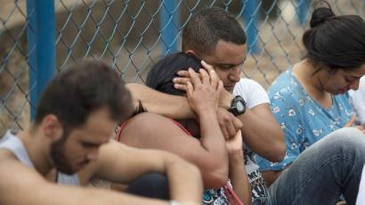 People wait for information about missing friends and relatives who disappeared after a dam collapse in Brumadinho, Brazil, on Jan. 26, 2019.