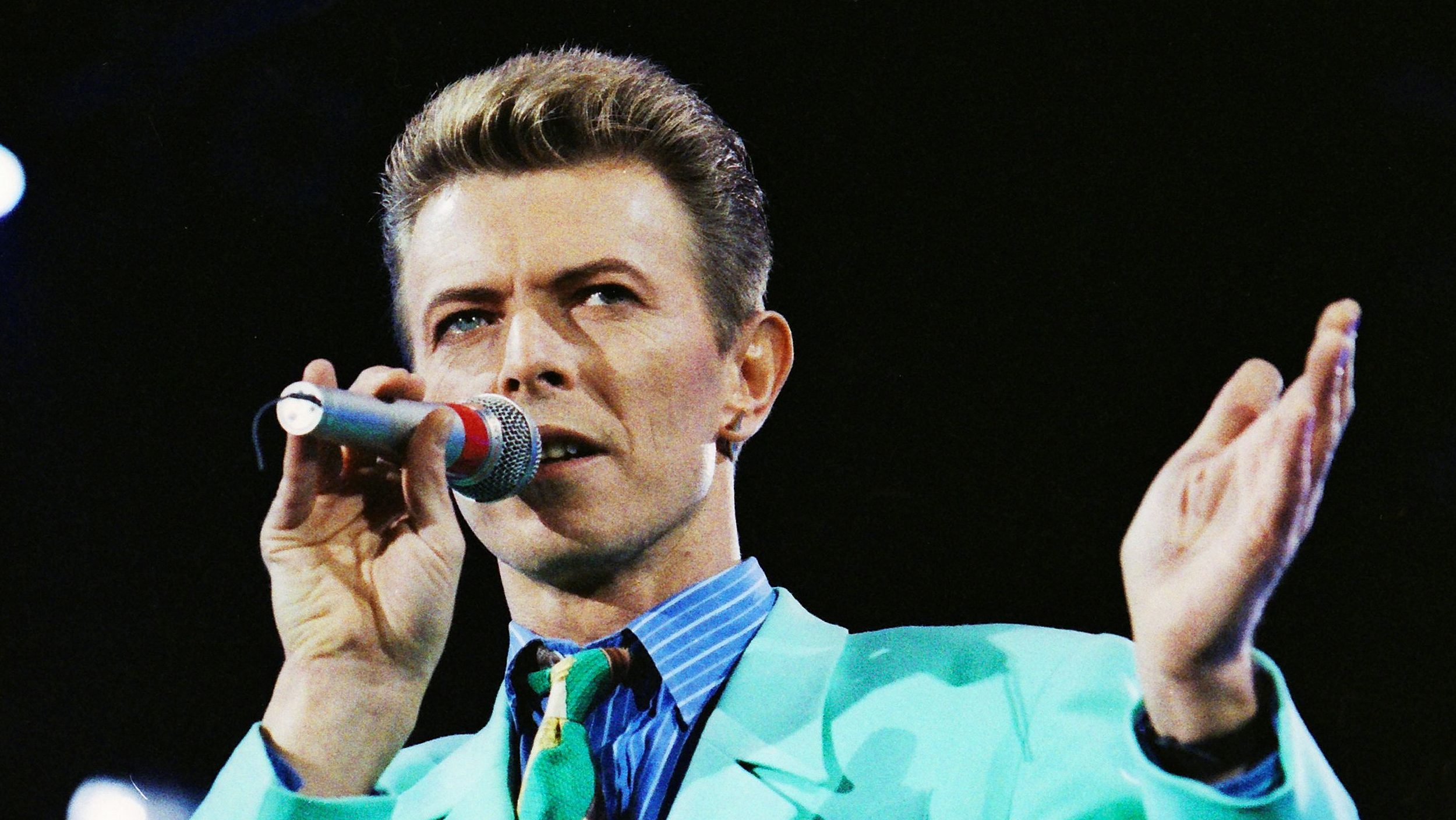 David Bowie performs on stage during The Freddie Mercury Tribute Concert at Wembley Stadium in London, Britain April 20, 1992