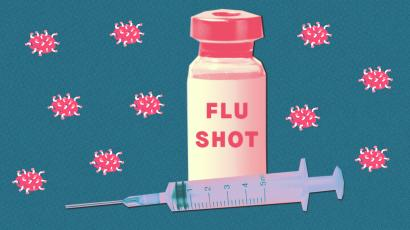 A vaccine vile and a syringe with cartoon flu viruses surrounding it.