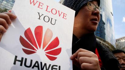 a visitor from China, holds a sign in support of Huawei outside of the B.C. Supreme Court bail hearing of Huawei CFO Meng Wanzhou, who is being held on an extradition warrant in Vancouver, British Columbia, Canada December 10, 2018. REUTERS/David Ryder/File Photo - RC179918A790