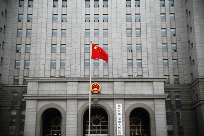 A Chinese national flag flutters in front of the building of the Number 2 Intermediate People's Court in Beijing, China September 22, 2016.