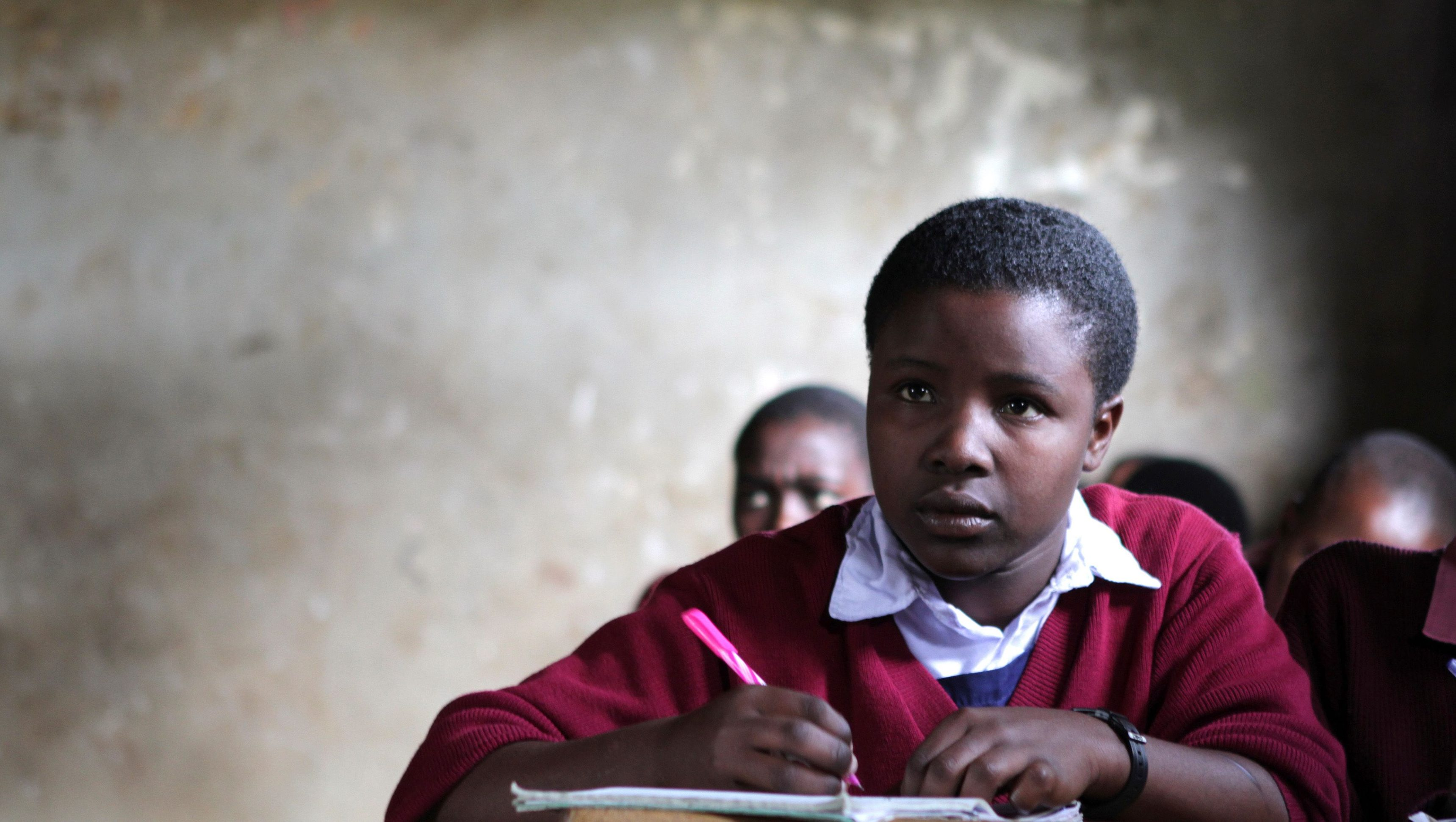 Eunice Metian sits in her classroom in Sajiloni Primary School in the semi-arid Kajiado County, south of Kenya's capital Nairobi, June 12, 2012. With help from German Agro Action, the school was able to build a sustainable water tank, freeing students from the task of fetching water and allowing them to spend more time on their homework and improving their results, according to deputy headteacher Elizabeth. By 2025, two-thirds of people worldwide are expected to face water shortages as businesses, agriculture and growing populations compete for the ever more precious commodity. Picture taken June 12, 2012.