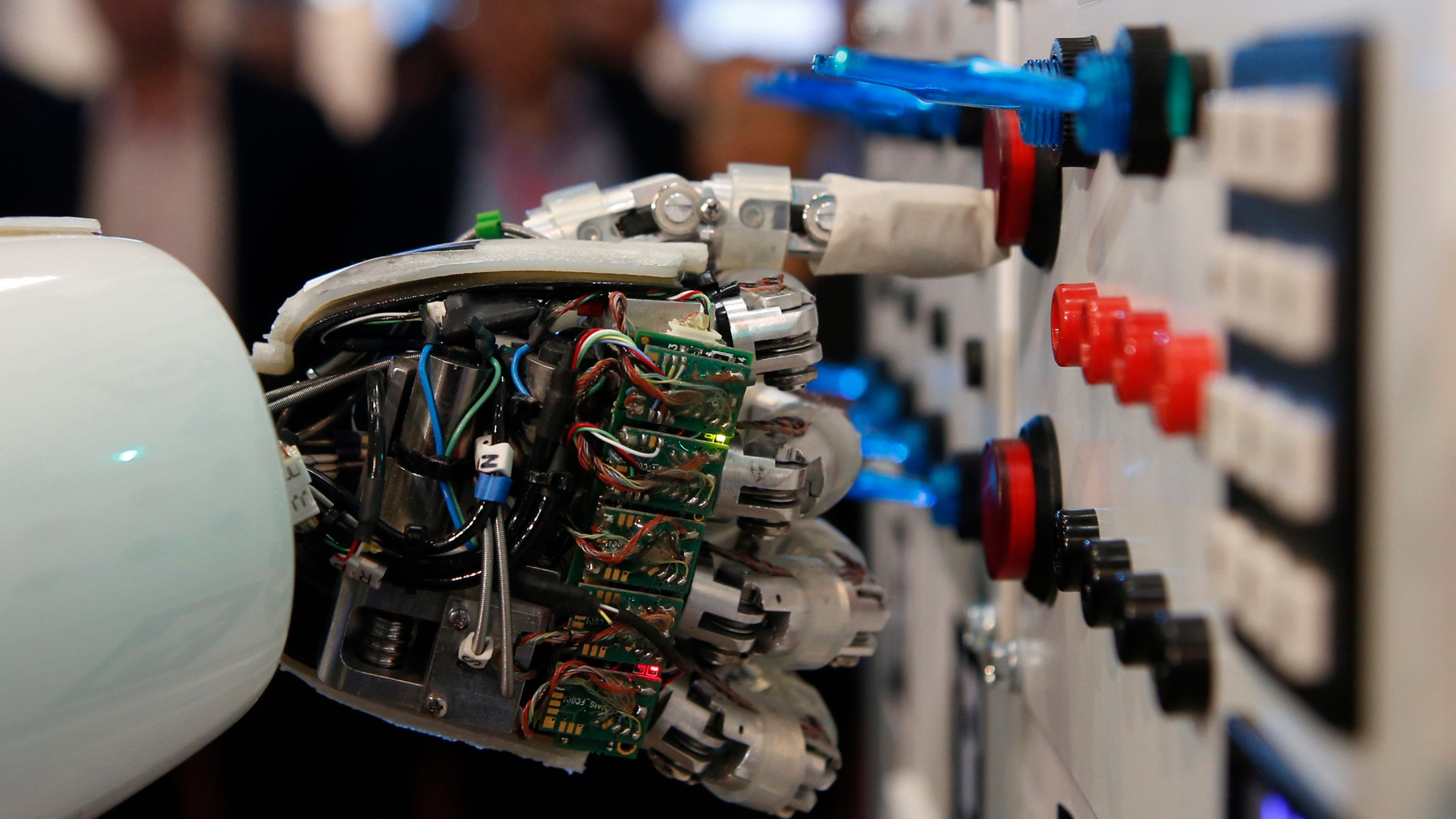 The hand of humanoid robot AILA (artificial intelligence lightweight android) operates a switchboard during a demonstration by the German research centre for artificial intelligence at the CeBit computer fair in Hanover