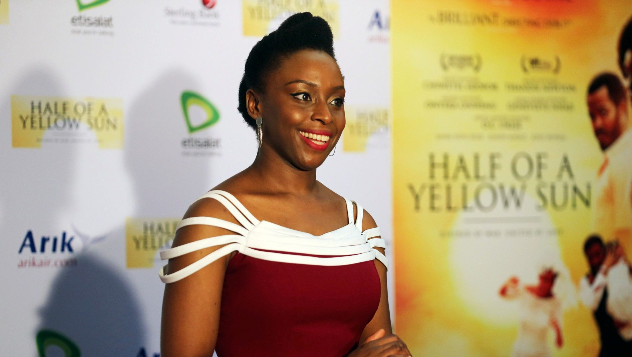 """Nigerian novelist Chimamanda Ngozi Adichie arrives for the premier of film """"Half of a Yellow Sun"""", an adaptation of her book, in Lagos April 12, 2014."""