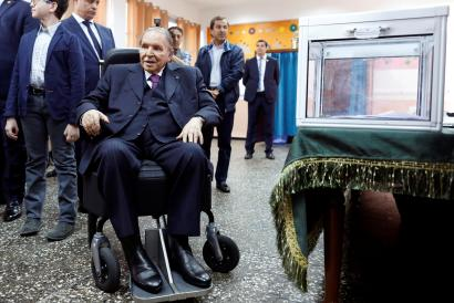 Algeria's President Abdelaziz Bouteflika looks at journalists after casting his ballot during the parliamentary election in Algiers, Algeria, May 4, 2017.