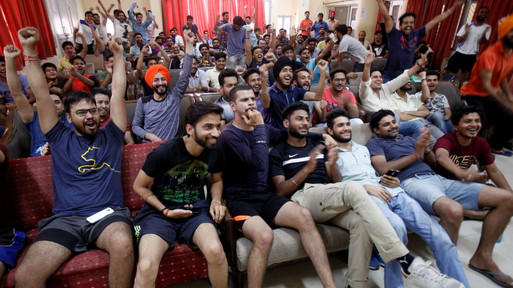 Indian cricket fans cheer as they watch on screen the Champions Trophy finals between India and Pakistan at London's The Oval, in a university hostel in Chandigarh