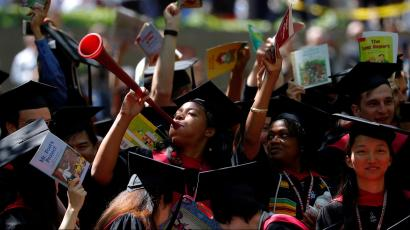 Students from the Graduate School of Education cheer as they receive their degrees during the 367th Commencement Exercises at Harvard University in Cambridge