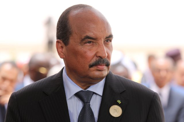 Mauritania's President Mohamed Ould Abdel Aziz waits for the arrival of the French President at Nouakchott airport, Mauritania, July 2, 2018. Macron, making an exceptional appearance at an African Union (AU) summit, was expected to discuss hurdles facing a five-nation French-backed anti-terror unit, the