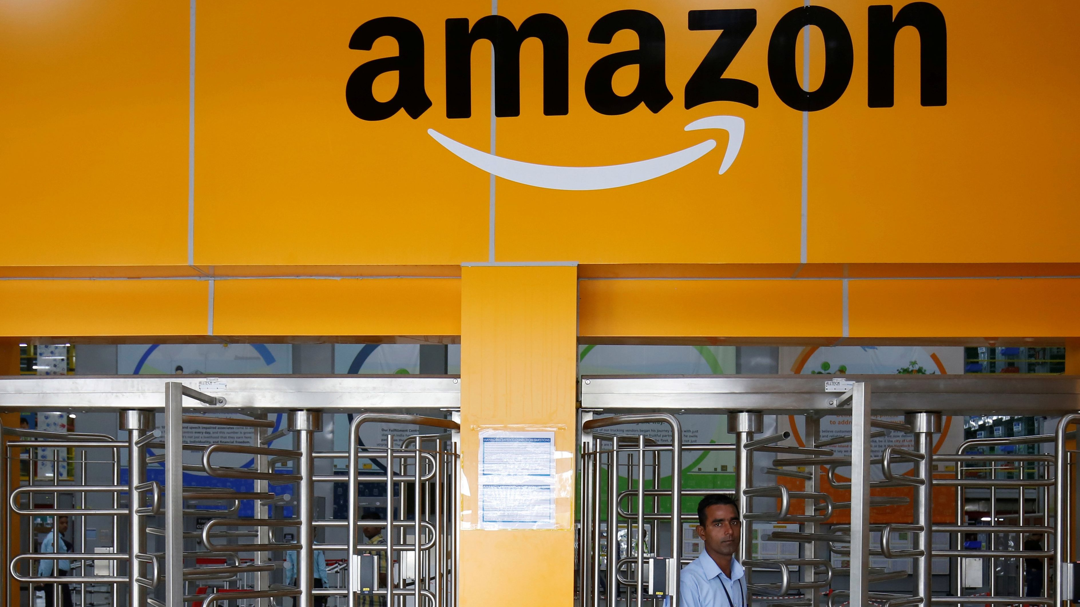 An employee of Amazon walks through a turnstile gate inside an Amazon Fulfillment Centre (BLR7) on the outskirts of Bengaluru