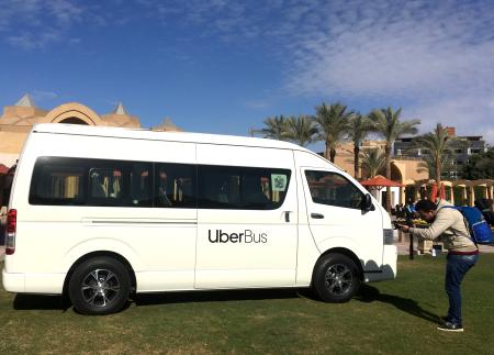 "A member of media takes a picture of ""UberBus"", a new project microbus by Uber, after a news conference in Cairo, Egypt, December 4, 2018."