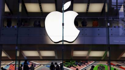 FILE PHOTO - Customers can be seen inside the Apple store in central Sydney, Australia