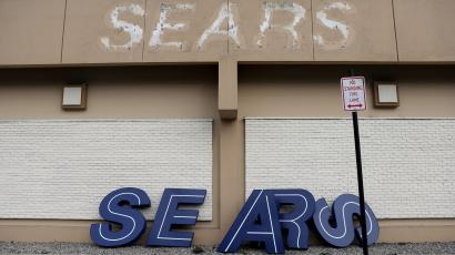 FILE PHOTO: A dismantled sign sits leaning outside a Sears department store one day after it closed as part of multiple store closures by Sears Holdings Corp in the United States in Nanuet, New York, U.S., January 7, 2019. REUTERS/Mike Segar/File Photo - RC14FA16C0A0