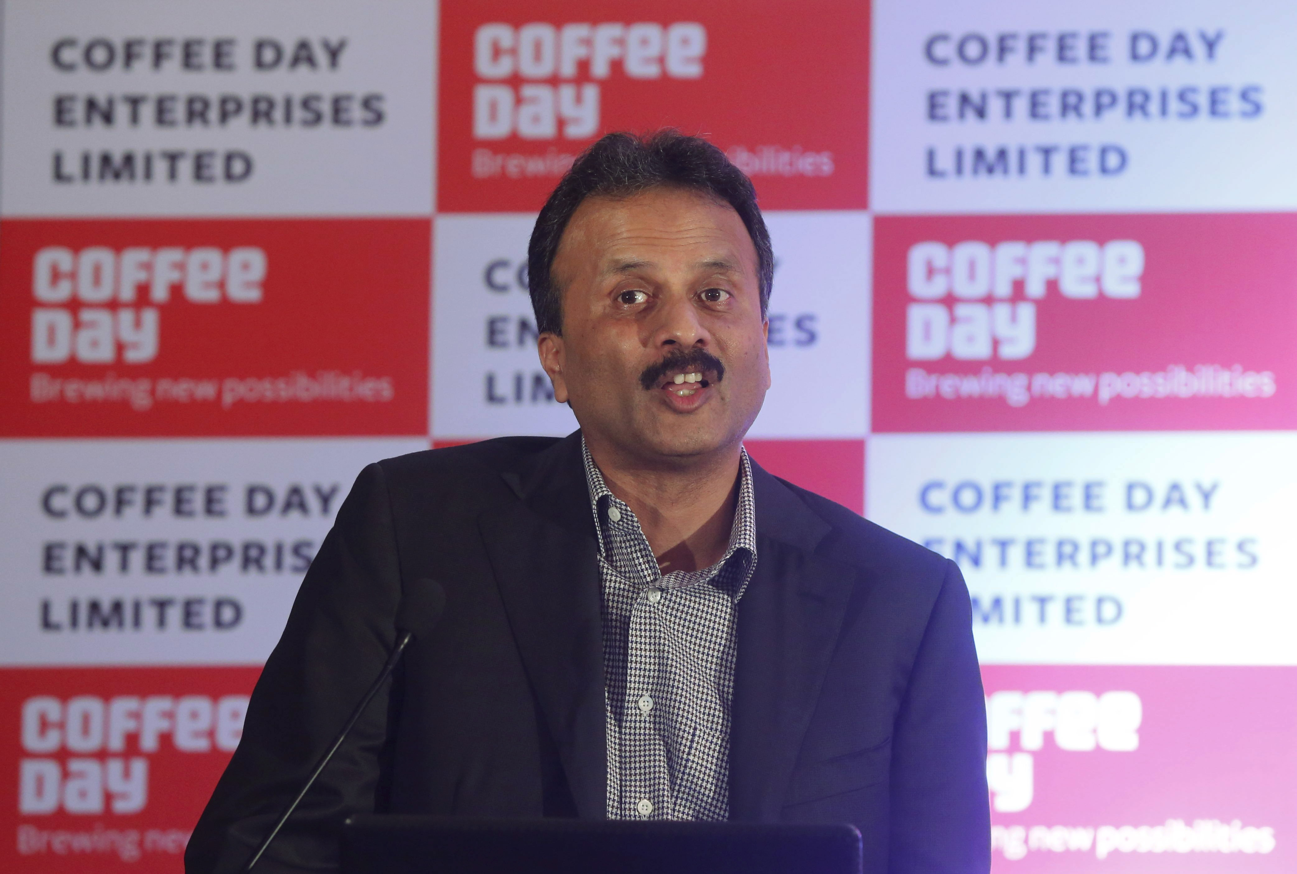 V.G. Siddhartha, chairman of Coffee Day Enterprises Ltd, speaks during a news conference in Mumbai