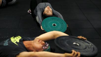 Kim Jin-ah, 31, exercises during a crossfit class at a gym in Seoul