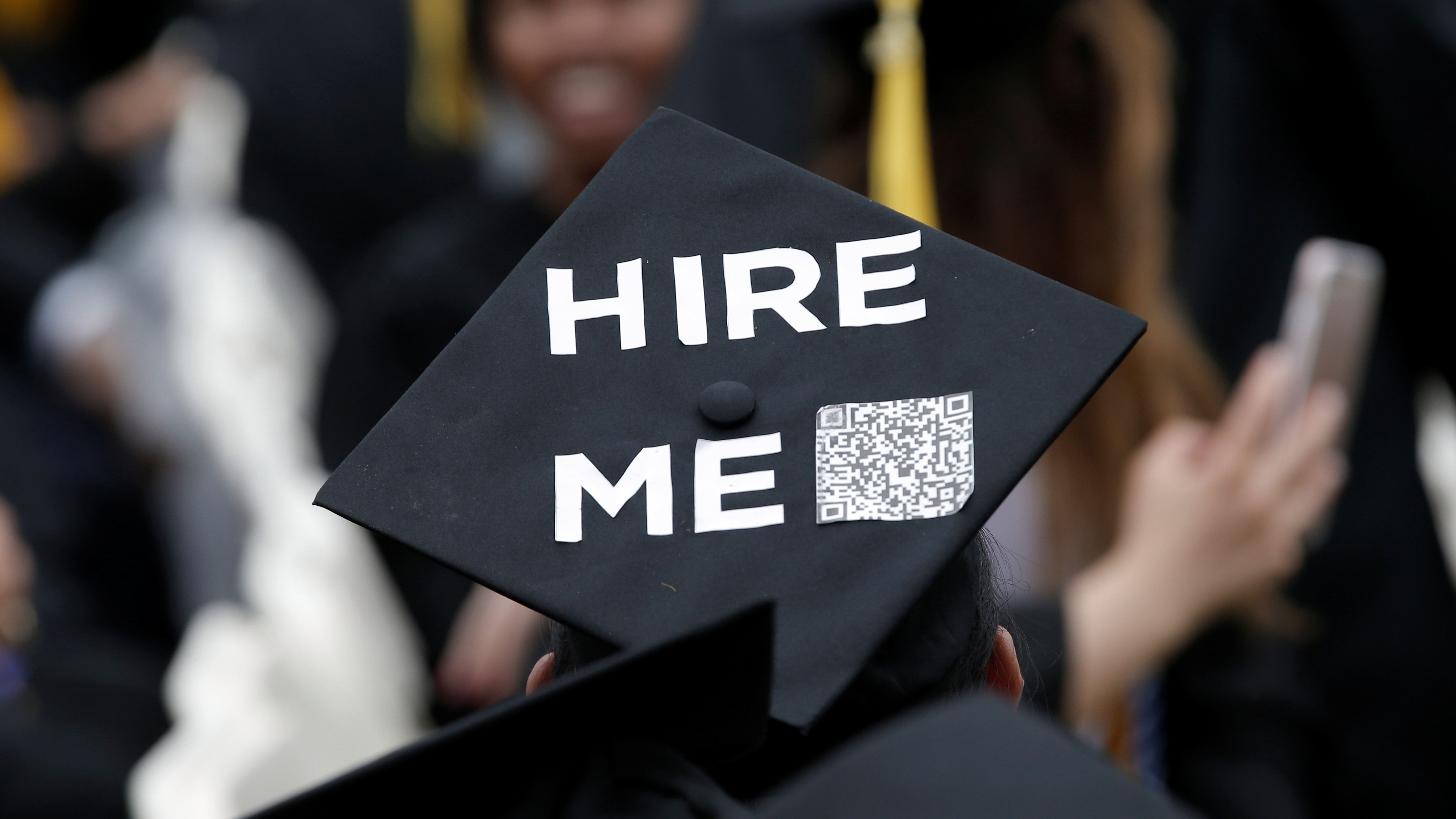 A graduating student of the CCNY wears a message on his cap during the College's commencement ceremony in the Harlem section of Manhattan, New York