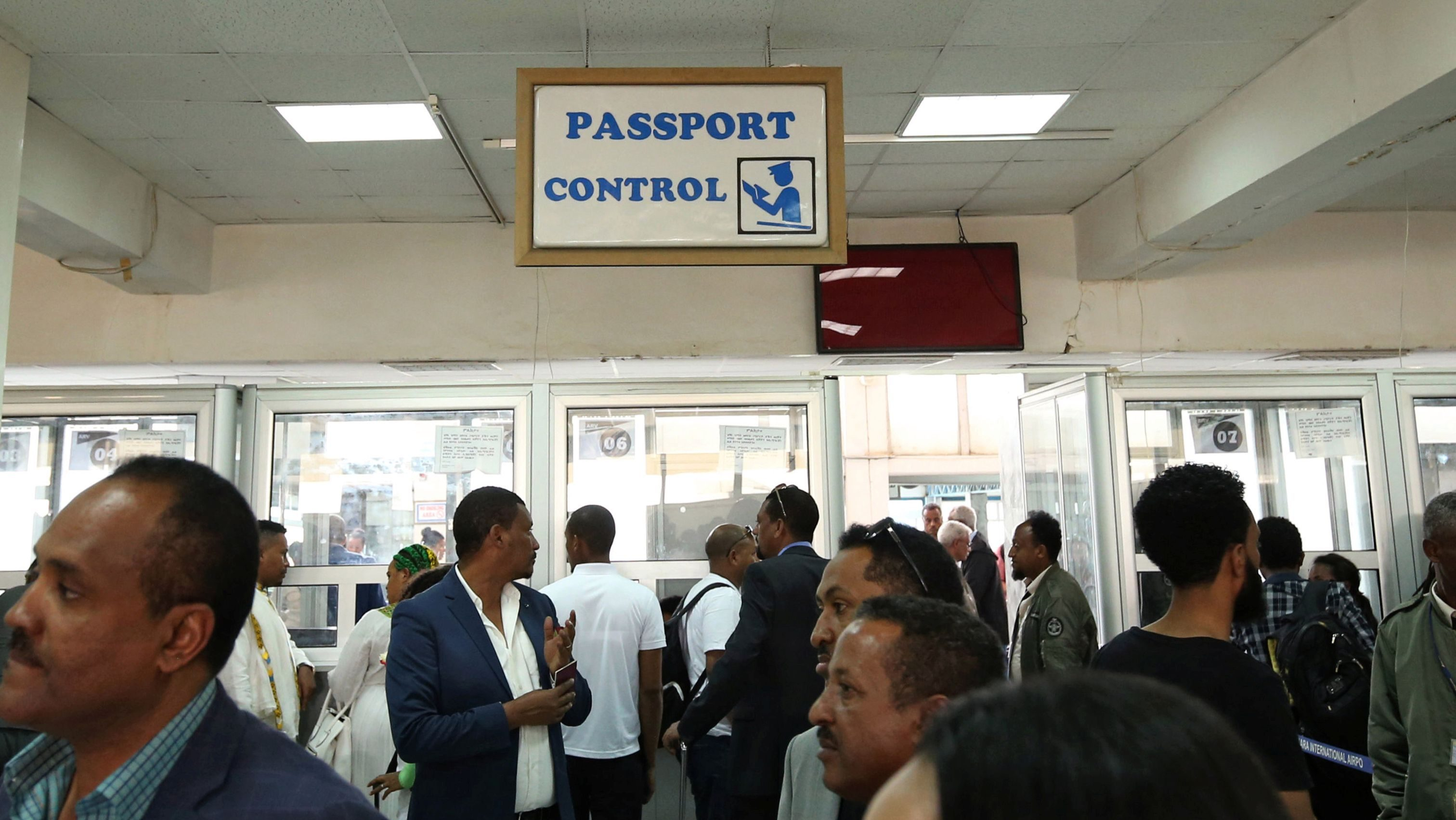 Passengers wait to be processed at the immigration section after arriving at the Asmara International Airport aboard an Ethiopian Airlines flight in Asmara, Eritrea July 18, 2018.