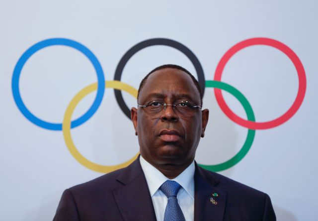 Senegal's President Macky Sall poses after signing the contract for the 2022 Youth Olympic Games, to be hosted in Senegal, at the 133rd IOC session in Buenos Aires, Argentina October 8, 2018.